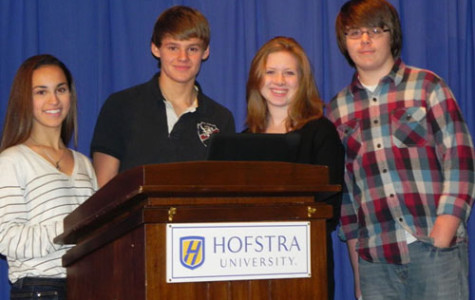 Freshmen Jules Robbins, Marc Cotter, Shannon Giere and Jesse Butcher prepare to present to parents about Facebook and Formspring.