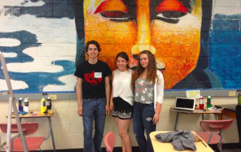 Connor Lynch, Daniela Tobar and Karen Quesada working on their mural.