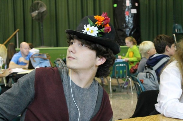 Chris Zito poses, clothed in floral attire for no specific reason, during his lunch period in the school cafeteria.