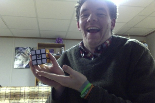 Scott Scopher Sinnickson poses with one of his Rubiks Cubes, after solving it in under a minute
