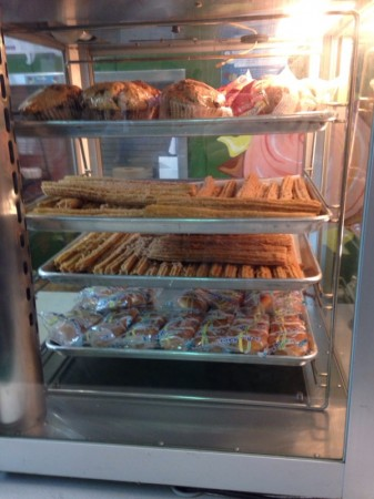 Churros feature prominently among muffins and other food items at the cafeteria.