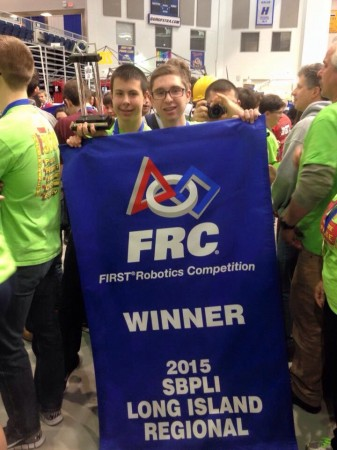 Alex Johnson (left) and Alex Jaquin (right) holding the winning banner.