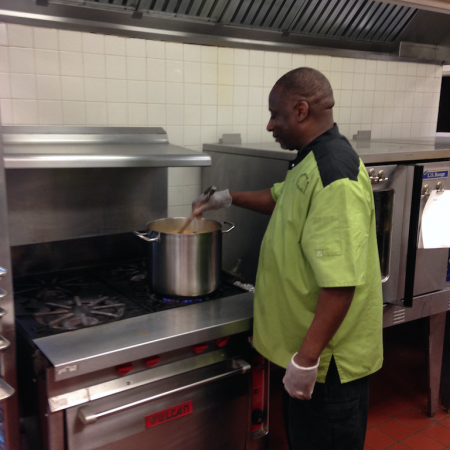 Chef Robert stirs hot soup in the WHBHS cafeteria on a sunny day in early May