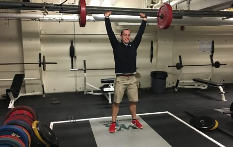Mr.Wingler lifting weights in the weight room