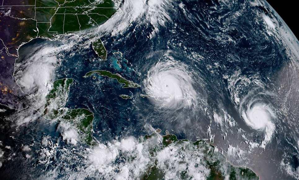 This satellite image obtained from the National Oceanic and Atmospheric Administration (NOAA) shows (L-R) Category 1, Hurricane Katia; Category 5, Hurricane Irma and, Category 1, Hurricane Jose at 1300UTC on September 7, 2017.  / AFP PHOTO  /Getty Images