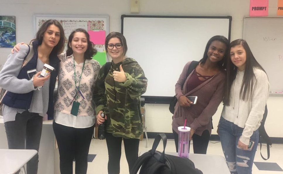 Ms. Galante (second from left) with her French III students.