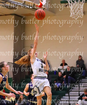 Molly McCarthy going up for a layup against Bayport-Blue Point