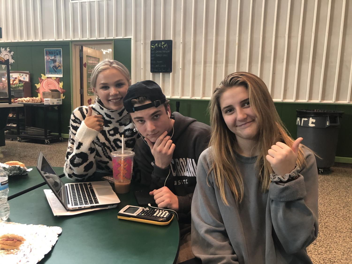 From left to right is Abby Gobler, Christian Capuano, and Caroline Henke