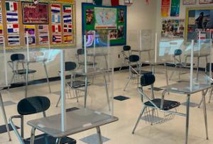 Plexiglass desk dividers shown here in a language classroom.
