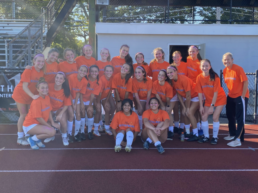 Girls Varsity Soccer team supporting Dezy Strong Foundation at their kicks for cancer game